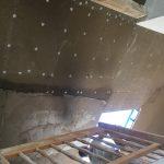 Montierte Lehm-Leichtbauplatten mit Armierungsgewebe und verspachteltem Lehmputz